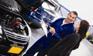 Woman talking to car mechanic